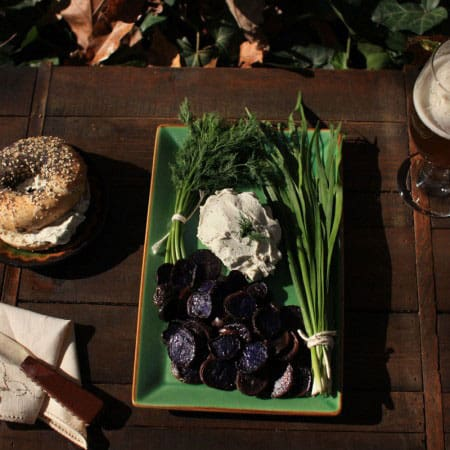 CrumbleBerry Hemp Garlic Chive Dill Cashew Cheese plated on a table