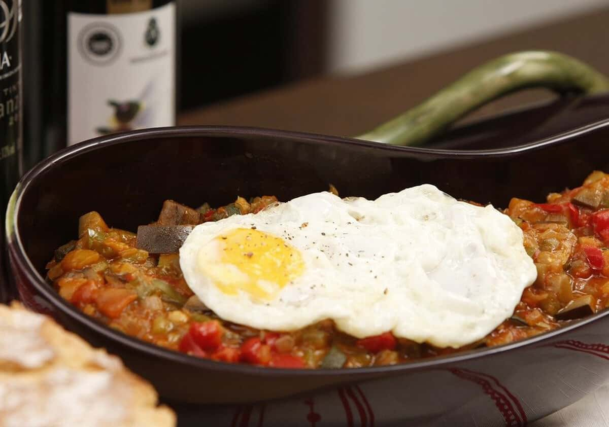 ratatouille dish with fried egg on top